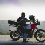 Abhijit Rao seated atop a hill on his Royal Enfield Himalayan kitted out with Big Bad Bikes's Gear